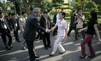 President George W. Bush greets passersby as he walks from Hanoi's Presidential Palace Friday, Nov. 17, 2006, to the Office of the Government where he met with Viet Prime Minister Nguyen Tan Dung. White House photo by Eric Draper.