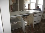 Bro Rob wrestles with old kitchen cabinet