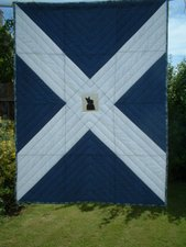 Scottish Saltire Quilt with King Robert the Bruce Statue in cross stitch