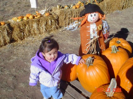 Kaleigh in the pumpkin patch.