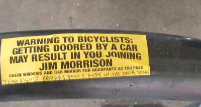Image of sticker on bike rack at Rainbow Grocery in San Francisco