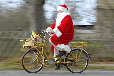 Image of Santa Claus on a bicycle