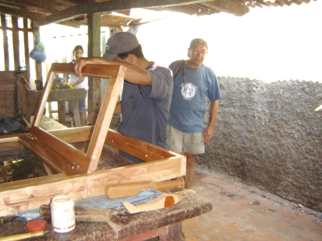 Viewing the first window at the local carpenters' shop