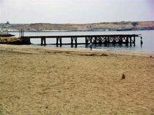 Praia das Miragens, ponte, baía e falésia