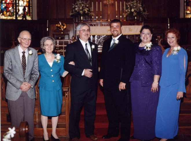 Chris with his parents and grandparents.