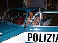 Me inside an an Italian police car...