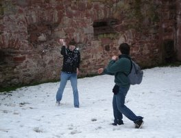 Snowball fight outside of a medieval German castle