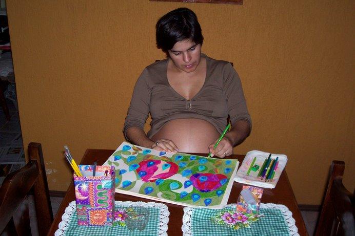 a autora pintando...