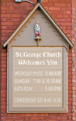 Saint George Catholic Church, in Hermann, Missouri - sign of Mass times