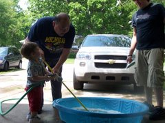 Tate and Papa Fill the Pool