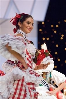 3bfb0fbbe In this photo released by Miss Universe L.P., LLLP, Valerie Domnguez, Miss  Colombia 2006, introduces herself in her national costume during a taping  of the ...