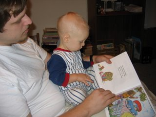 Matthew in Rick's lap reading a book