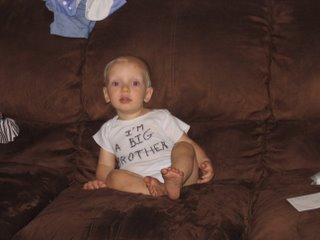 Matthew sitting on the couch with a shirt that says I'm a big brother