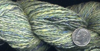 Yarn from dyed silk carrier rods.