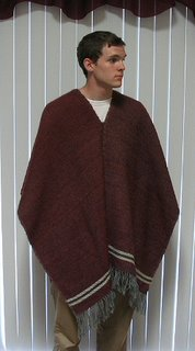 Handsome young man modeling my handspun, handwoven poncho.