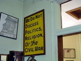 """This vintage sign, on display at the Tucumcari Historical Museum, reads """"We do not discuss Politics, Religion, or the Civil War."""""""