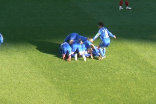 Suwon players celebrate Baek's goal