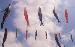 Suijin matsuri - carp streamers are strung across the river