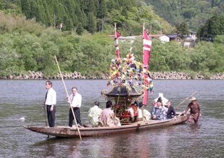 Suijin matsuri - the mikoshi are floated on traditional boats