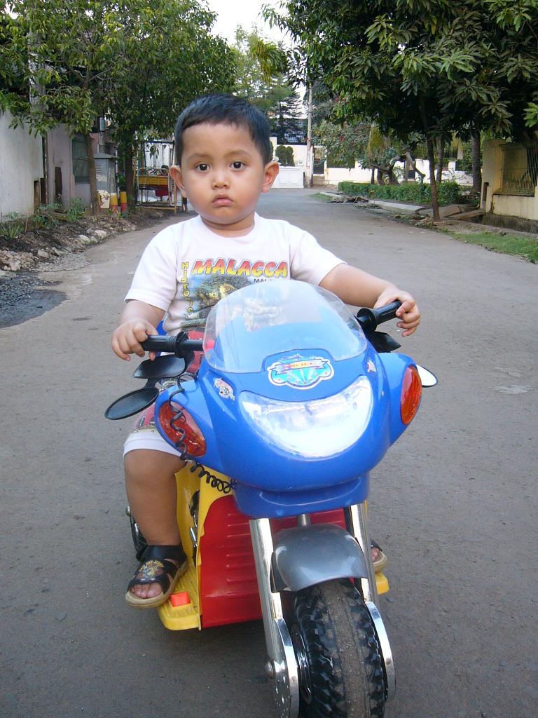 little boy on motorcycle-#35