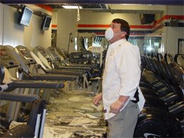 Mike Milbury inspects destroyed workout room