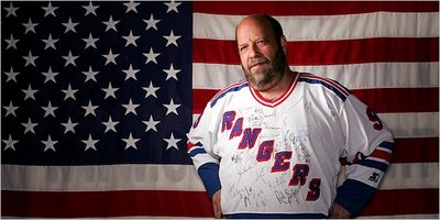 Fuzzy - Donald Cohen - wearing his Rangers jersey. It has been signed by 50 players over the years.