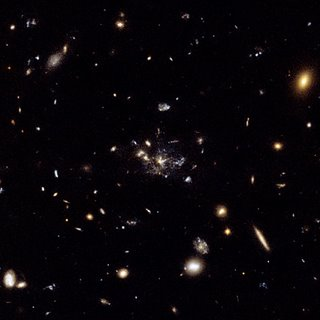 GIS Sites: Hubble's New Images - Galaxy caught in the making