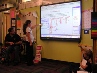 Smartboards replace whiteboards; new ops for in-school ads.