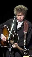 bob dylan playing a gibson j-45 acoustic guitar