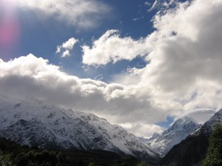 Photo by Rullsenberg: clouds over the Southern Alps, New Zealand