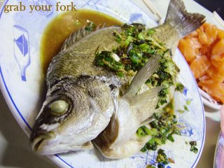 Steamed whole perch with ginger and shallots