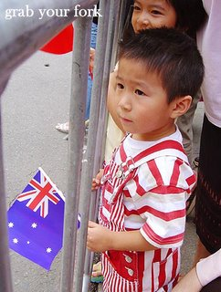 Chinese New Year parade Sydney 2006 boy with an Australian flag