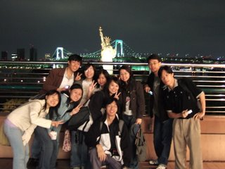 Taking photo with the statue of liberty and the rainbow bridge
