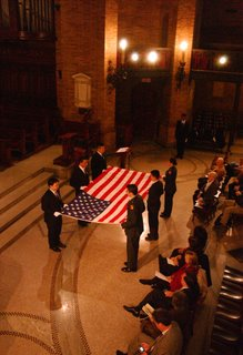 Columbia milvets folding the flag in Saint Paul's Chapel Columbia University