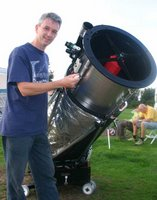 Martin Lewis with his telescope