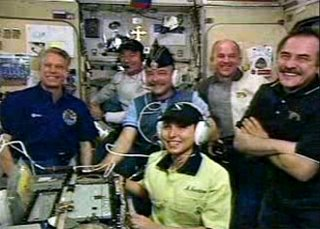 Anousheh, front, with astronauts on the space station