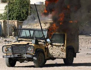 A Snatch Land Rover on fire after an IED attack