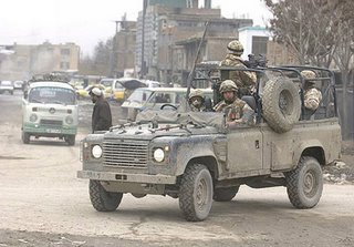 An open-topped Land Rover in downtown Kabul - a balance of protection, mobility and risk