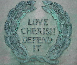 Love Cherish Defend It at base of American flag Low Plaza Columbia University