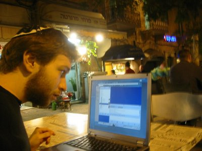 Daniel Shakhmundes goes on-line for free in Israel, using downtown Jerusalem's public wireless internet access