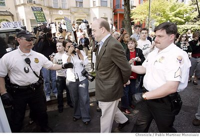 Rep. Jim McGovern, D-Mass., is escorted to a police vehicle by members of the Uniform Division of the Secret Service after his arrest during a demonstration outside the Sudanese Embassy in Washington. Associated Press photo by Pablo Martinez Monsivais