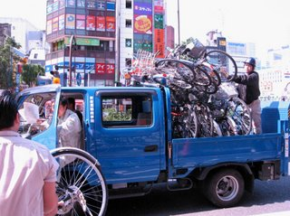 Collection truck for illegally parked bicycles, Shinjuku, Tokyo.