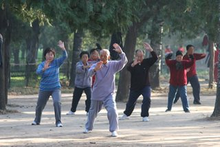 A group of older people practicing taichi in a Beijing park