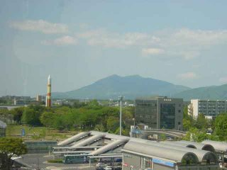 A view of Tsukuba with the rocket at the Expo Center and the twin peaks of Mt. Tsukuba in the background
