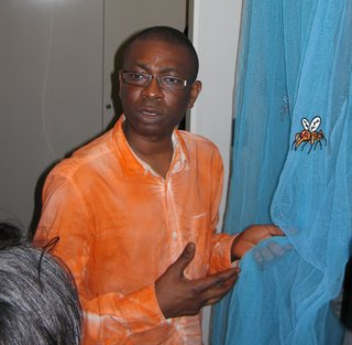 Youssou N'Dour displaying UNICEF mosquito net.