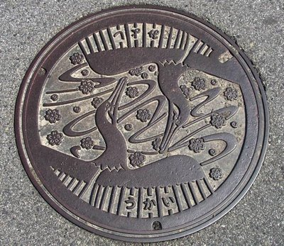 Drain, Miyoshi, Hiroshima Prefecture. The birds are cormorants, used for fishing as in the more well known Arashiyama near Kyoto