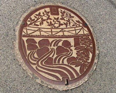 Water Manhole. Izumo-Minari, Shimane. The image depicts a bridge over the Hii river
