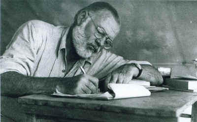 Ernest Hemingway, writing in Kenya, 1953