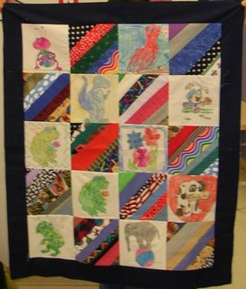 quilt top with crayon colored pictures