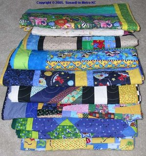 stack of 9 quilts